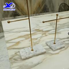 Gold and marble jewelry stand
